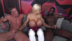 Cougar slut deals two monster dicks in a dissipated threesome