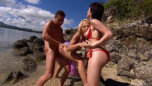 Excellent nude sex by the beach with two MILFs and a local man